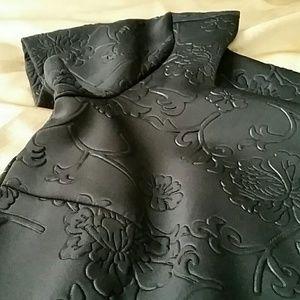 Black embossed dress